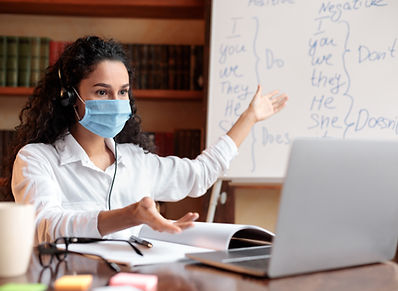 teacher-in-mask-having-video-conference-