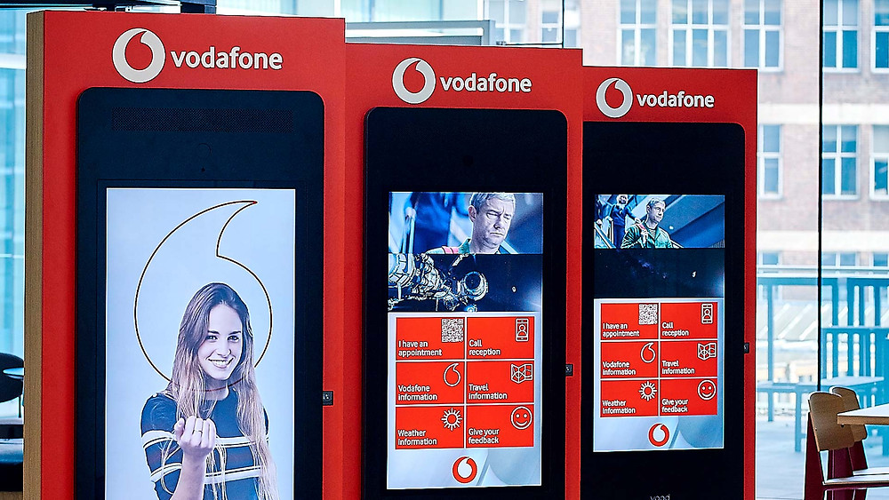 visitor management companies - vodafone kiosk