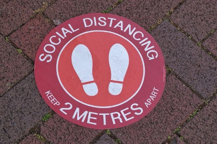 reception-management-social-distancing-sign
