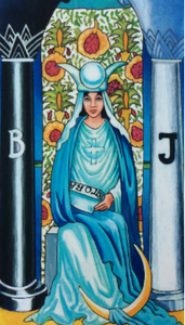 A dark haired woman sits on a throne in front of a pomegranate tree. She holds the Torah, and wears a cross on her chest and a diadem of crescent and full moons on her head. To each side, are pillars of palm trees.