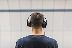 man-wearing-black-headphones-374832.jpg