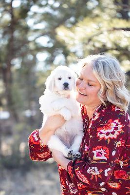 woman and golden retriever puppy