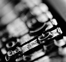 canva-typewriter,-types,-black-white-MAC