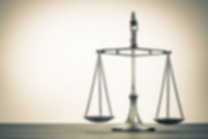Law scales on table. Symbol of justice.
