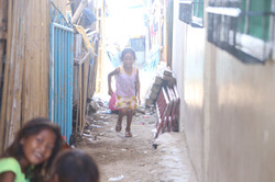 a child running toward her playmates