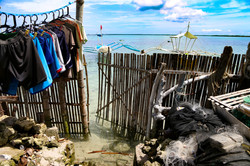 when it's high tide, the sea water will usually reach to the bamboo gate of the house