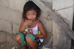 an innocent girl eating junk foods in the corner