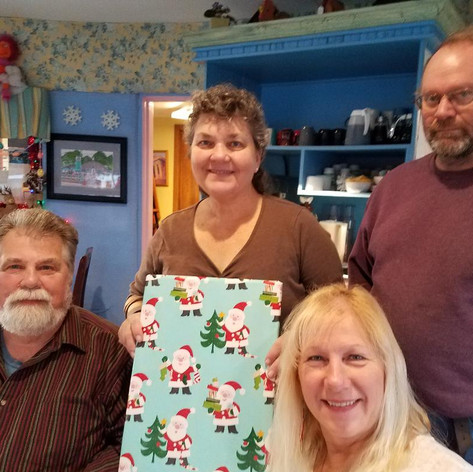 Dave, Donna, Denise, Jim Christmas present for Daddy Maxwells