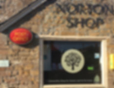 Post Office sign front of Norton shop store