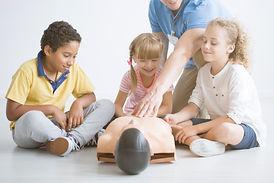 children-and-paramedic-have-fun-PMULUHU.