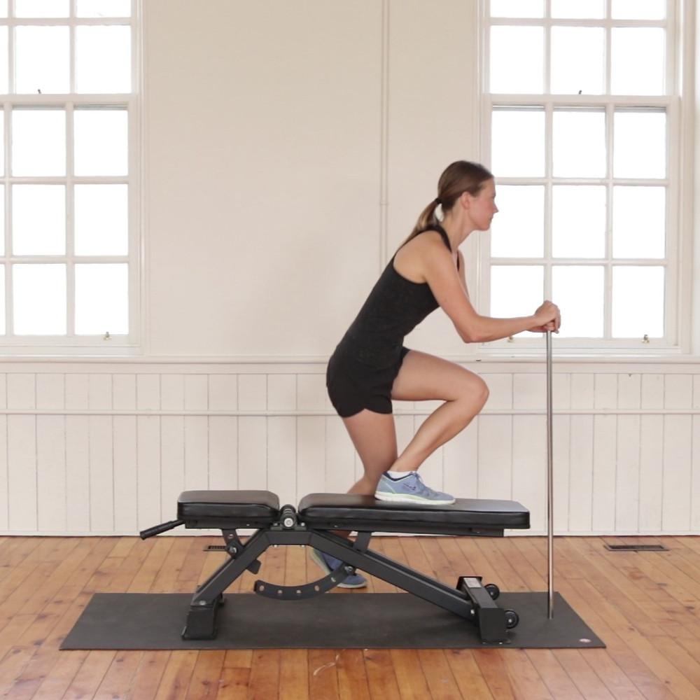 Women going a leg exercise on a weight bench
