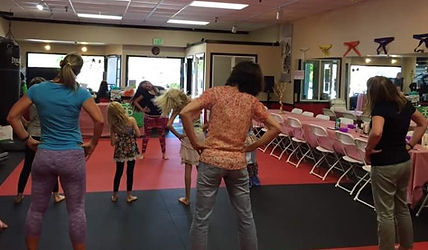 Kate showing a preview of a dance class for Bay Area Mother's and Daughter's on Mother's Day