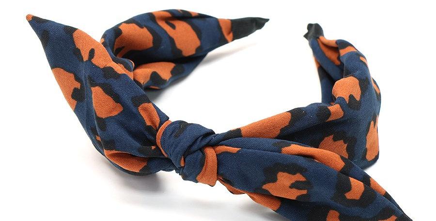 Fabric headband with adjustable bow in navy and orange animal print