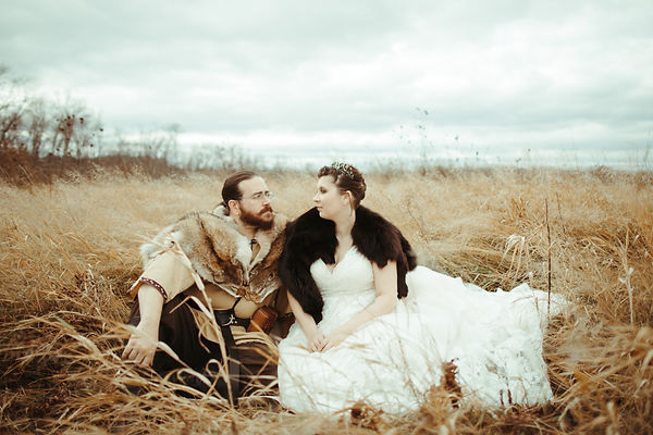 wedding portraits in field with tall golden grass