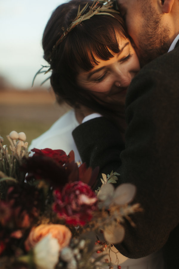bride and groom eloped warm embrace