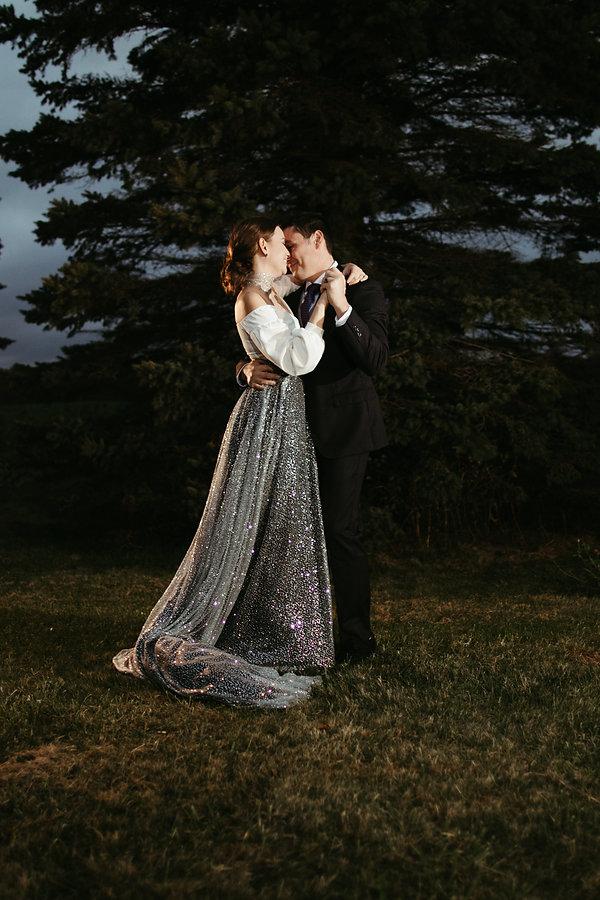bride and groom first dance, bride dress is sparkiling