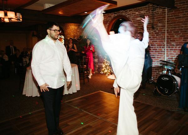 bride does high kick on dance floor