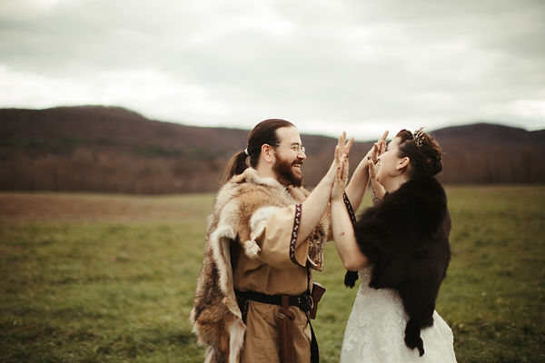non traditional wedding photography newly weds interlock fingers with western mass mountains in background
