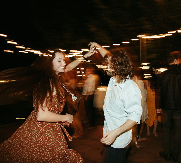 wedding reception dancing with light trails