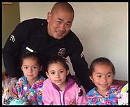 LAPD officer with kids-Guadalupe Center