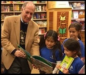 Marty Cooper reading a book to kids