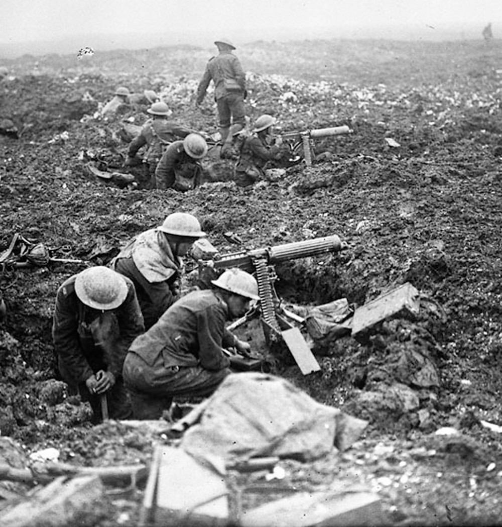 Canadian machine gunners dig themselves in, in shell holes on Vimy Ridge.