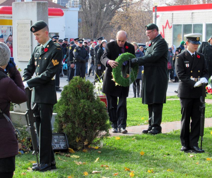 Mayor Mike Burkett lays a wreath