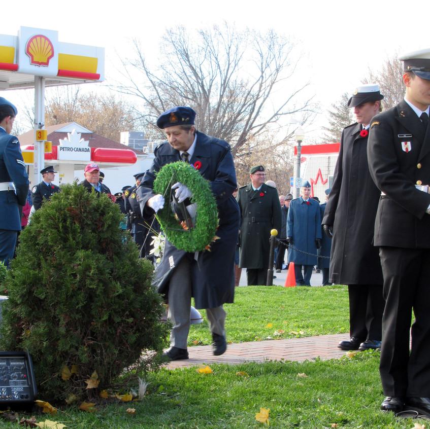 President Beth Scott lays a wreath
