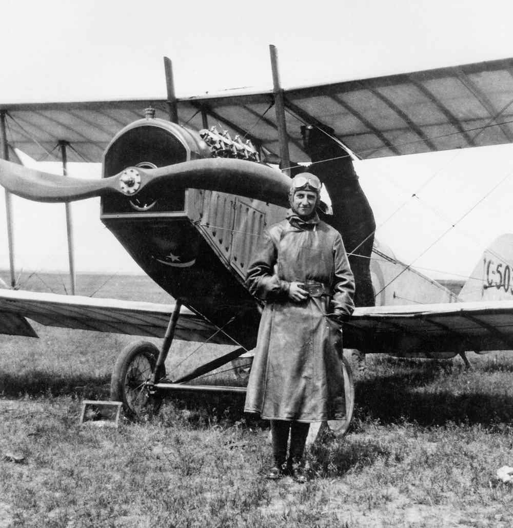 Cadet Hilliard Bell stands in front of a Curtiss JN-4, the main trainer aircraft for the 1917-18 RFC Canada training program.