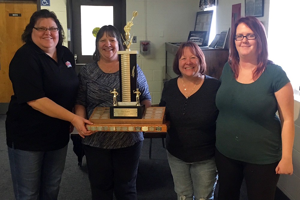 Shown here posing with their trophy are, left to right: Dianne Sauvé, Michele Russell, Annie McArthur, and Tori Vivian.