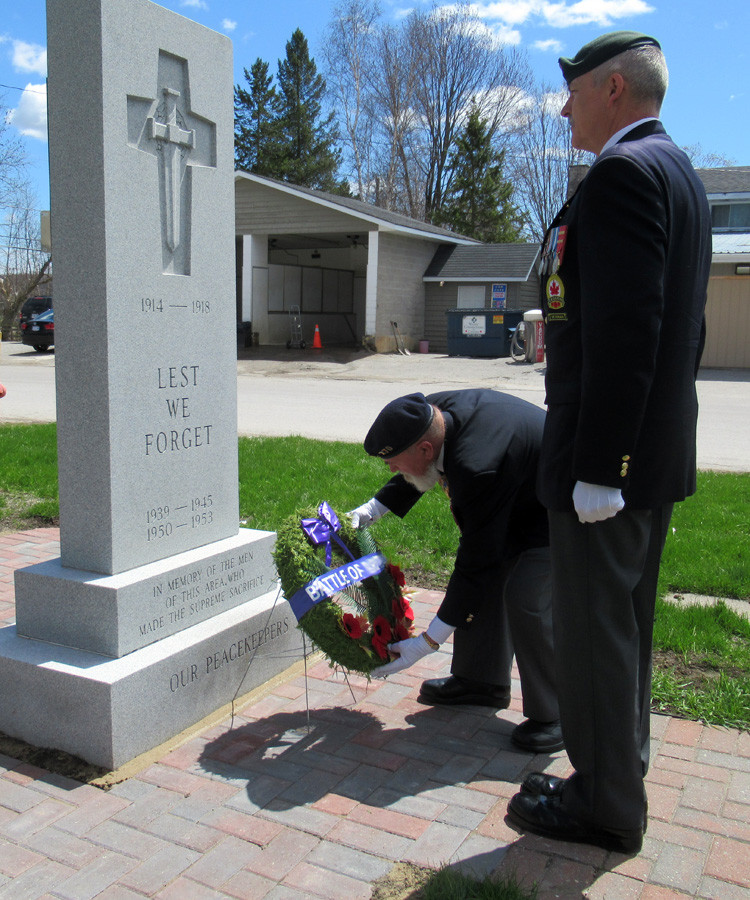 Seen here laying the wreath in remembrance of the Battle of the Atlantic is long-time member of the Royal Canadian Navy Comrade Tom Thompson, escorted by Comrade Rick Morse.