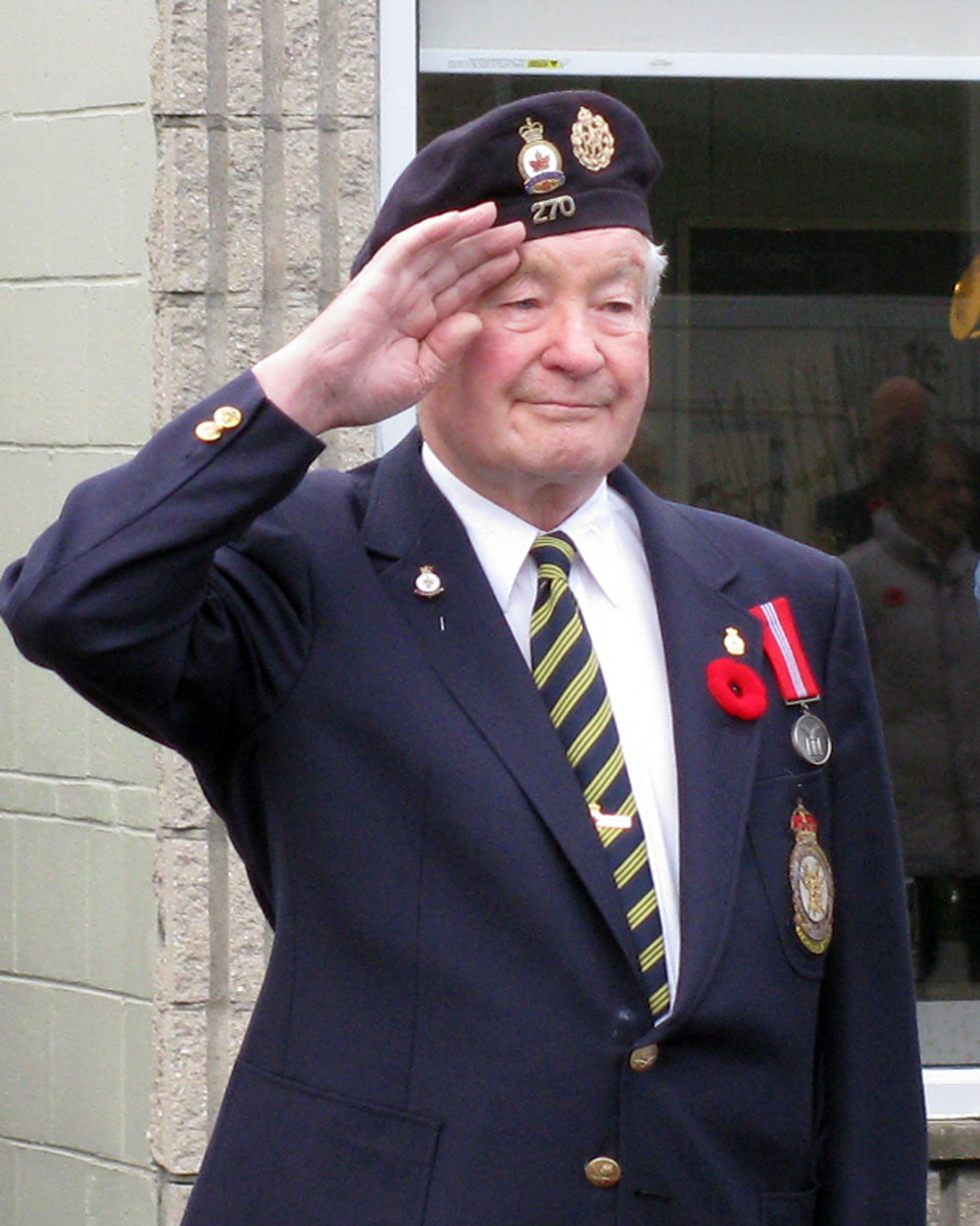 Veteran Bob Rice takes the salute at a Remembrance Day parade in Coldwater.