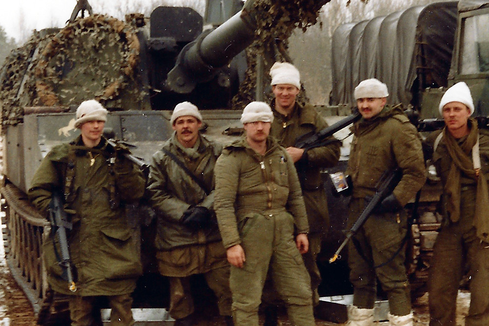 Corporal Steve Zeidler (tallest one in the middle) in front of an M-109 artillery self-propelled gun during his artillery days.