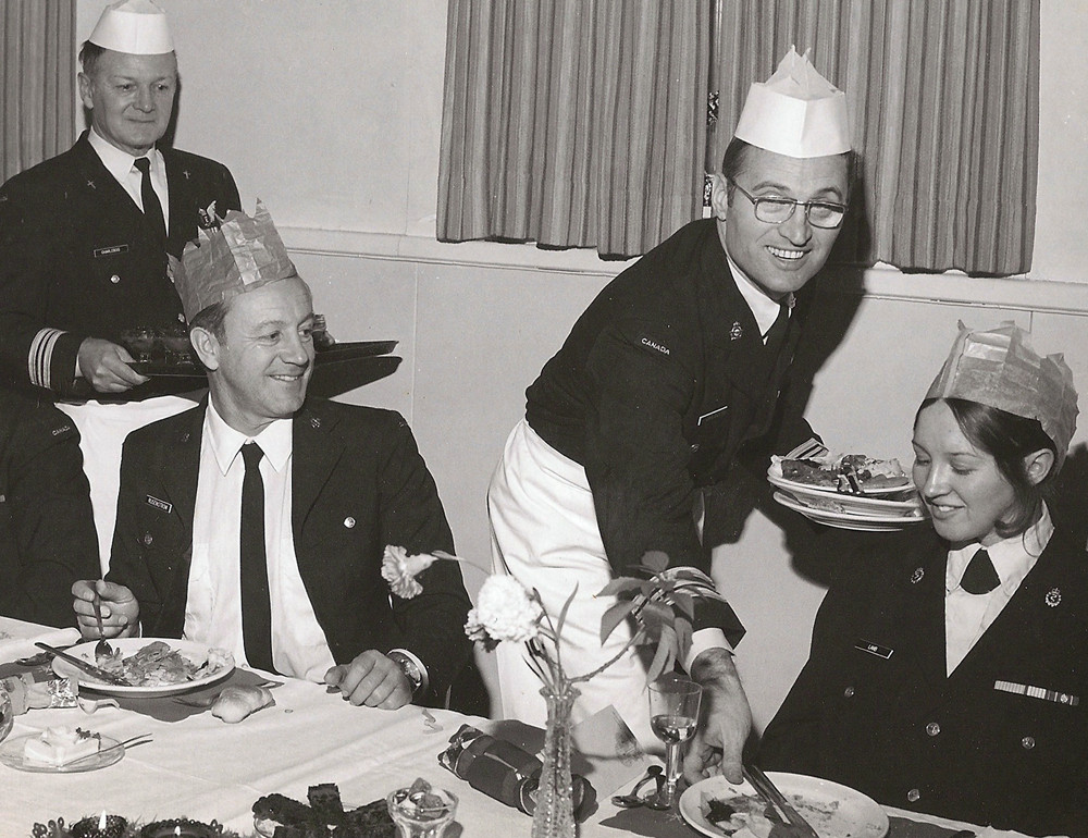 As Commander-for-the-day, then Private Wanda Beaudoin of Coldwater (right) is served by a senior officer during the 1975 Junior Ranks Christmas Dinner in Ottawa.