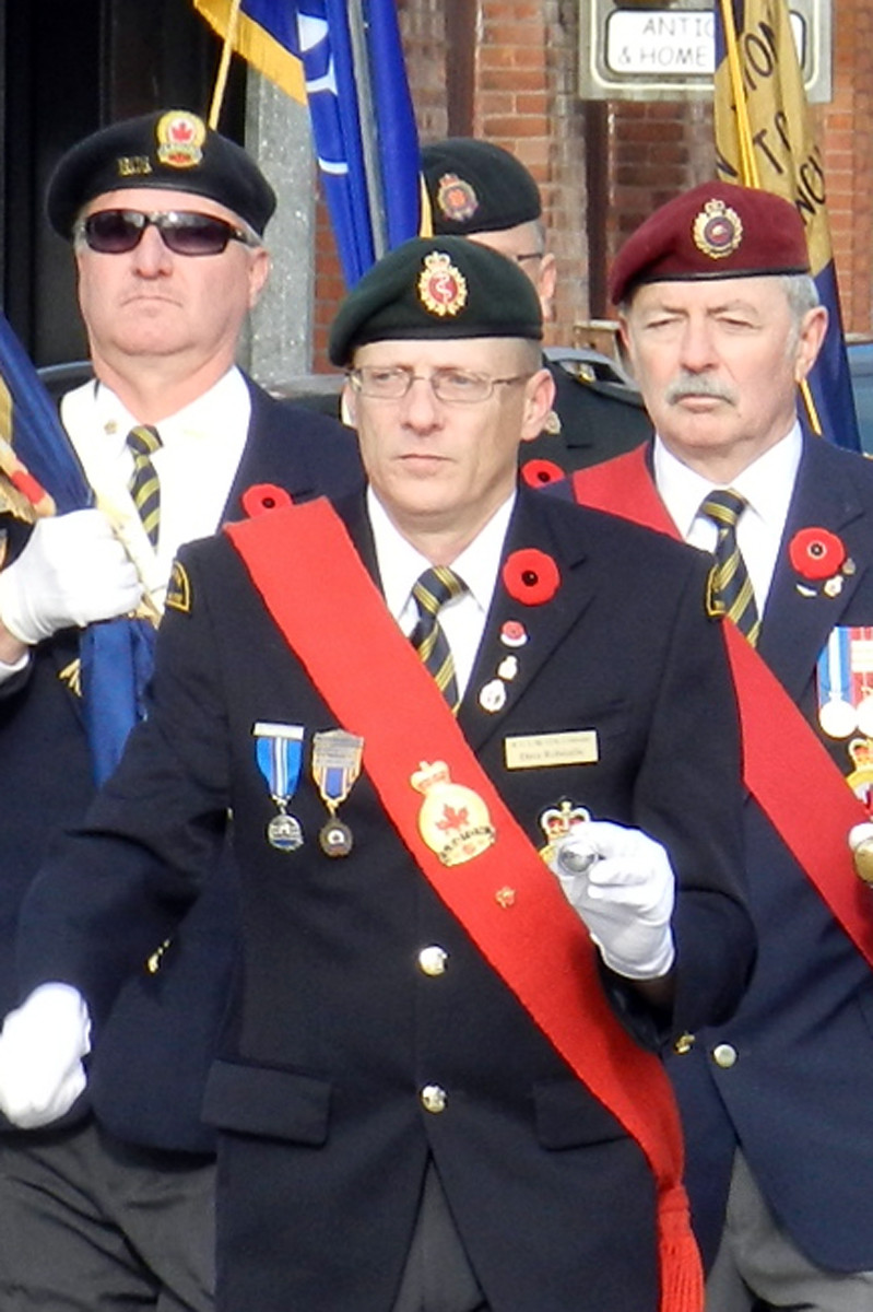 Comrade Dave Robitaille (center), Sergeant-At-Arms at Branch 270 Coldwater, leads a Remembrance Day parade in 2016.