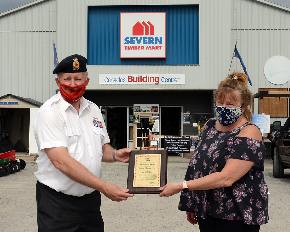Coldwater Branch president Norm Marion (left), presenting the Friendship Award to Severn Timber Mart owner, Heather Mallard.