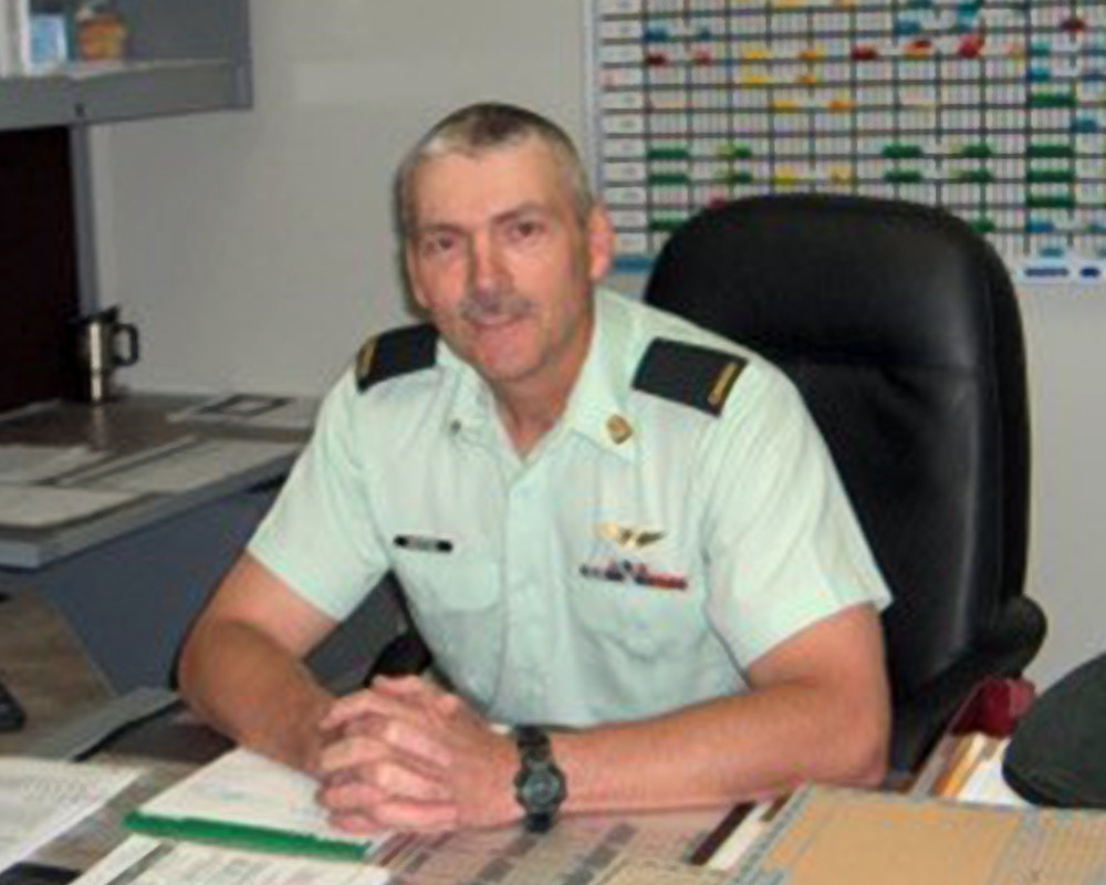 Comrade Rick Morse at his desk while he served as Sergeant Major of the Training Cadre for the Resource Management Support occupation at the Canadian Forces School of Administration and Logistics, CFB Borden.