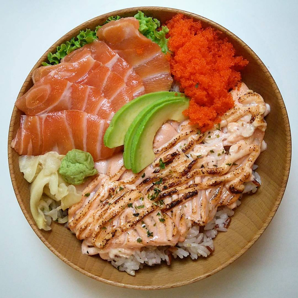 Salmon sashimi and mentaiko salmon on yuzu ume rice