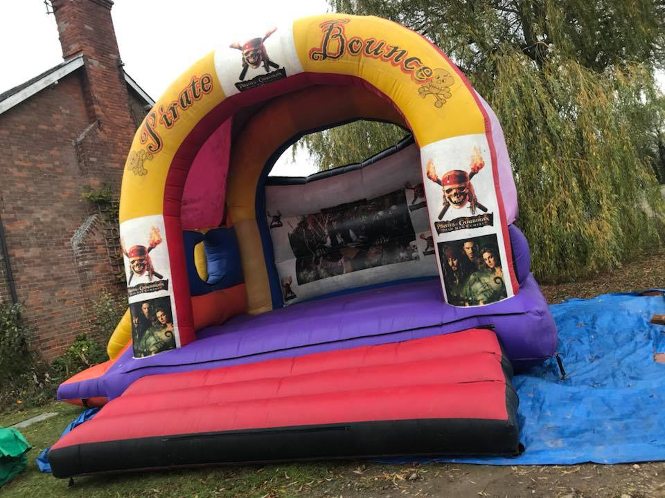 15 x 21 Foot Pirates Of The Caribbean Bouncy Castle 1 - Bouncy Castle Hire - www.bigbouncybriers.co