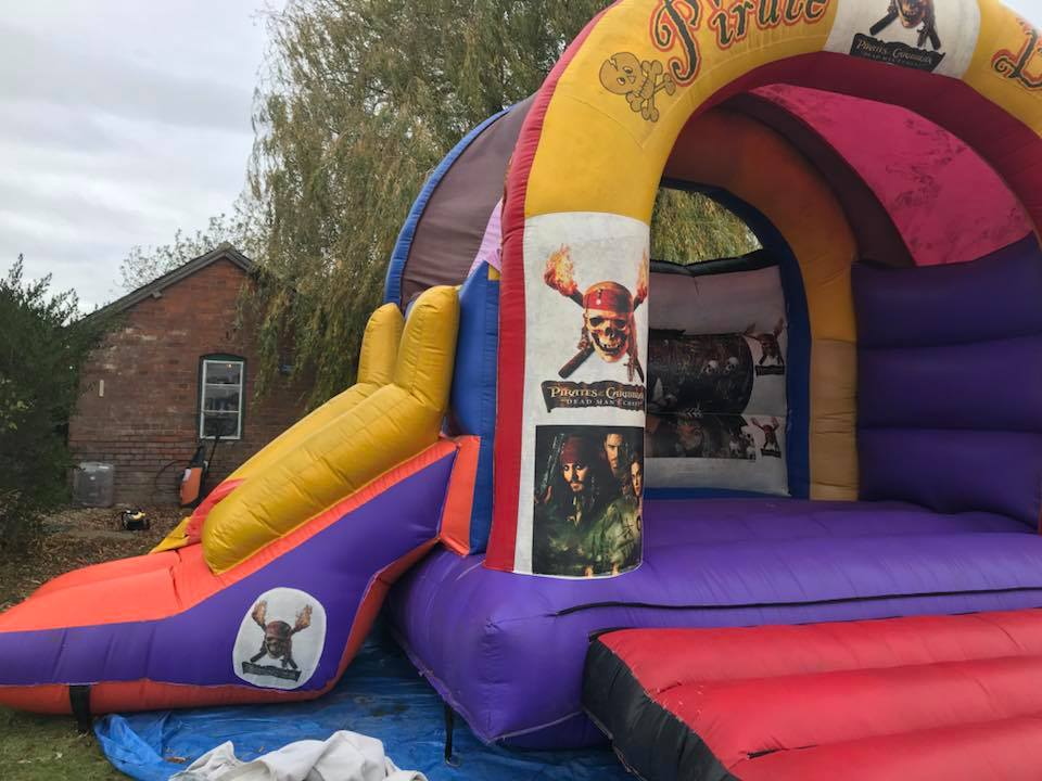15 x 21 Foot Pirates Of The Caribbean Bouncy Castle - Bouncy Castle Hire - www.bigbouncybriers.co