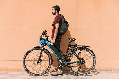 urban-cyclist-standing-e-bike.jpg