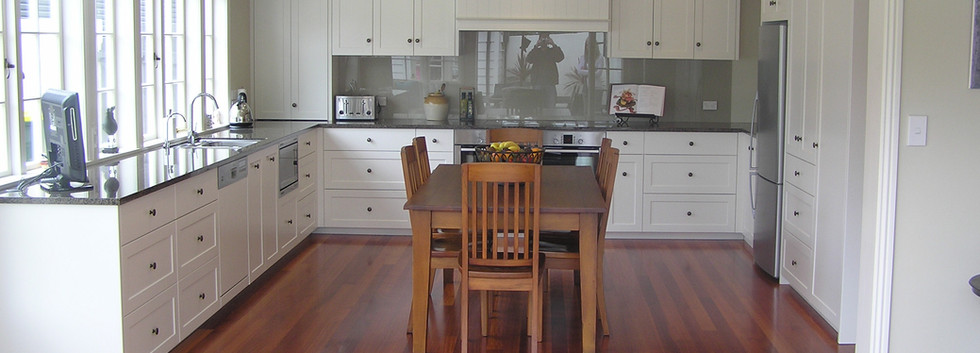 Wooden Dining Table in White Kitchen.JPG