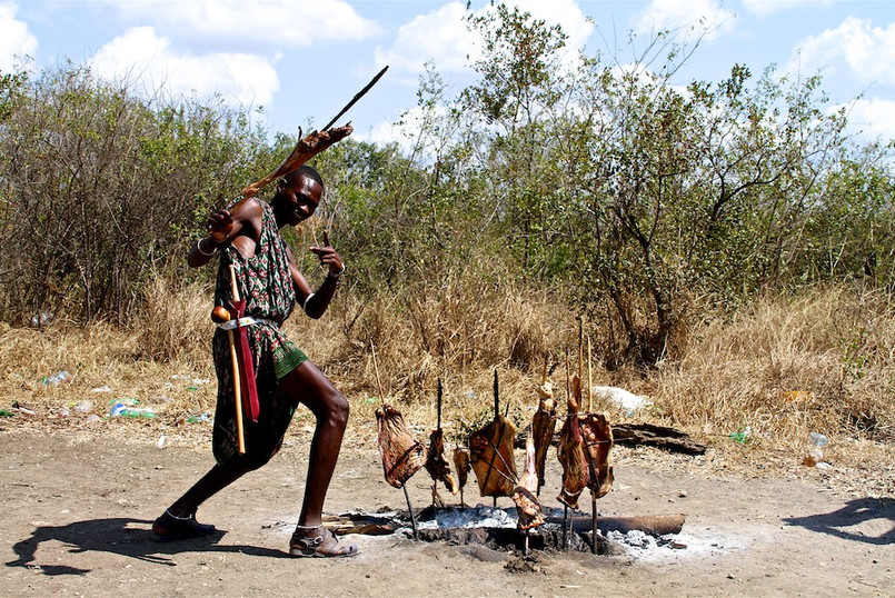 Maasai selling BBQ goat on the road