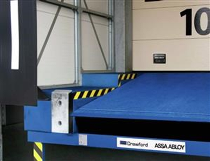 Dock Leveler Bridges the gap to ensure smooth and safe transfer of goods between Vehicle and Loading Dock