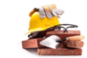 Burnt clay bricks, yellow helmet with gl