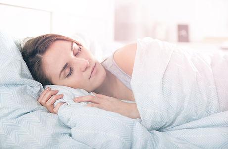 girl-peacefully-sleeping-in-the-morning-