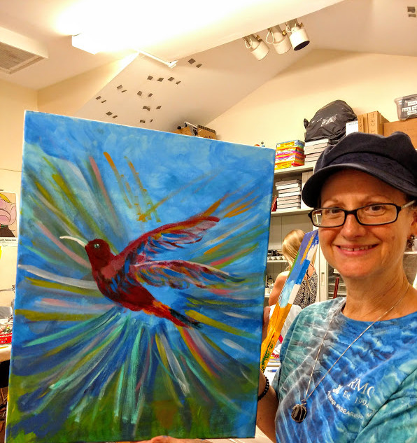 Julie and her painting.jpg