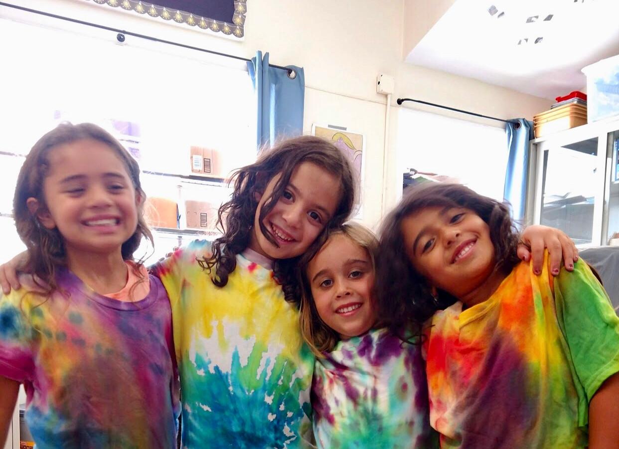 Girls with wearing tie dye shirts.jpg