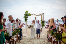 real bride wearing bohemian lace wedddin