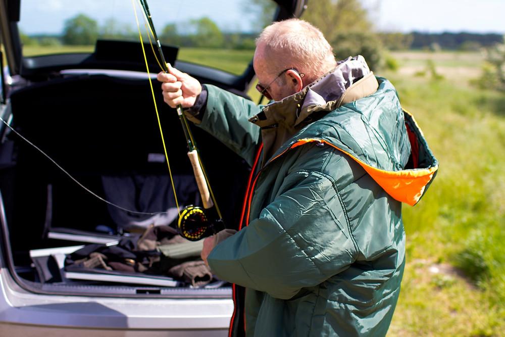 Older man fishing wearing a Sittingsuit